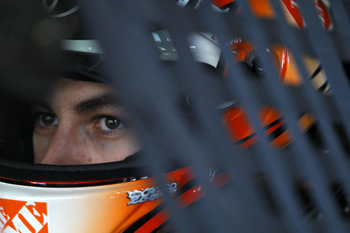 HOMESTEAD, FL - NOVEMBER 20:  Joey Logano, driver of the #20 Home Depot Toyota, sits in his car during practice for the NASCAR Sprint Cup Series Ford 400 at Homestead-Miami Speedway on November 20, 2010 in Homestead, Florida.  (Photo by Chris Trotman/Gett