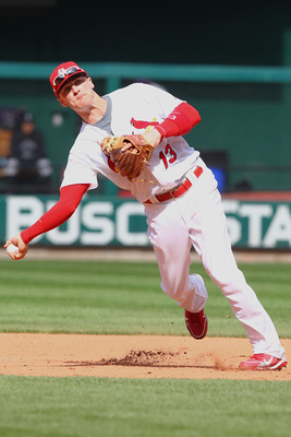 ST. LOUIS - OCTOBER 2: Brendan Ryan #13 of the St. Louis Cardinals throws to first base against the Colorado Rockies at Busch Stadium on October 2, 2010 in St. Louis, Missouri.  The Cardinals beat the Rockies 1-0 in 11 innings.  (Photo by Dilip Vishwanat/