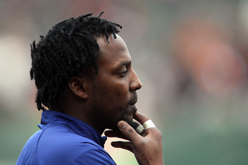 SAN FRANCISCO - OCTOBER 28:  Vladimir Guerrero #27 of the Texas Rangers looks on during batting practice before Game Two of the 2010 MLB World Series against the San Francisco Giants at AT&T Park on October 28, 2010 in San Francisco, California.  (Photo b