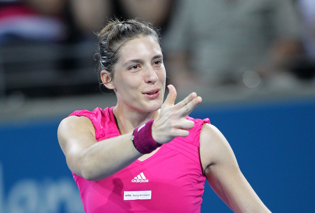 BRISBANE, AUSTRALIA - JANUARY 07:  Andrea Petkovic of Germany celebrates victory after her semi final match against Marion Bartoli of France during day six of the Brisbane International at Queensland Tennis Centre on January 7, 2011 in Brisbane, Australia