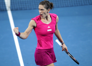 BRISBANE, AUSTRALIA - JANUARY 07:  Andrea Petkovic of Germany celebrates after winning the first set during her semi final match against Marion Bartoli of France during day six of the Brisbane International at Queensland Tennis Centre on January 7, 2011 i