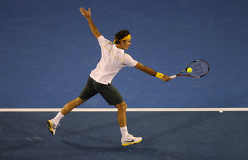 MELBOURNE, AUSTRALIA - JANUARY 19:  Roger Federer of Switzerland plays a backhand in his second round match against Gilles Simon of France during day three of the 2011 Australian Open at Melbourne Park on January 19, 2011 in Melbourne, Australia.  (Photo