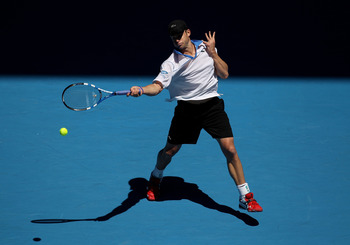 MELBOURNE, AUSTRALIA - JANUARY 19:  Andy Roddick of the United States of Americaplays a forehand in his second round match against Igor Kunitsyn of Russia during day three of the 2011 Australian Open at Melbourne Park on January 19, 2011 in Melbourne, Aus