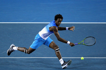 MELBOURNE, AUSTRALIA - JANUARY 19:  Gael Monfils of France plays a backhand in his second round match against Frederico Gil of Portugal during day three of the 2011 Australian Open at Melbourne Park on January 19, 2011 in Melbourne, Australia.  (Photo by