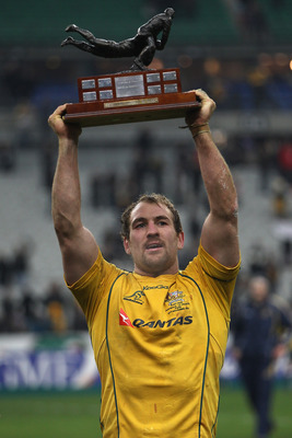 PARIS - NOVEMBER 27: Wallabies captain Rocky Elsom holds aloft the trophy after his side 59-16 victory during the Test match between France and the Australian Wallabies at the Stade de France on November 27, 2010 in Paris.  (Photo by Michael Steele/Getty