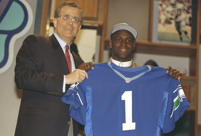 19 Apr 1997:  Cornerback Shawn Springs of the Ohio State Buckeyes holds a jersey of the Seattle Seahawks at the NFL Draft at Paramount Studios in Manhattan, New York.  Springs was the number three pick. Mandatory Credit: Al Bello  /Allsport