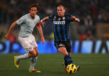 ROME, ITALY - DECEMBER 03:  Stefano Mauri (L) of SS Lazio competes for the ball with Wesley Sneijder of FC Internazionale Milano during the Serie A match between SS Lazio and FC Internazionale Milano at Stadio Olimpico on December 3, 2010 in Rome, Italy.