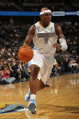 DENVER - NOVEMBER 16:  Al Harrington #7 of the Denver Nuggets dribbles the ball against the New York Knicks at the Pepsi Center on November 16, 2010 in Denver, Colorado. The Nuggets defeated the Knicks 120-118. NOTE TO USER: User expressly acknowledges an