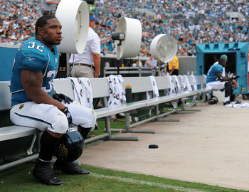 JACKSONVILLE, FL - SEPTEMBER 26:  Running back Maurice Jones-Drew #32 of the Jacksonville Jaguars sits on the sidelines watching his team take on the Philadelphia Eagles at EverBank Field on September 26, 2010 in Jacksonville, Florida. The Eagles defeated
