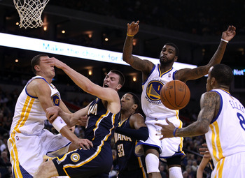 OAKLAND, CA - JANUARY 19:  Tyler Hansbrough #50 of the Indiana Pacers has a shot blocked by Dorell Wright #1 of the Golden State Warriors at Oracle Arena on January 19, 2011 in Oakland, California.  NOTE TO USER: User expressly acknowledges and agrees tha