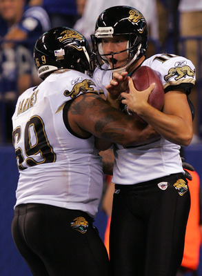 INDIANAPOLIS - SEPTEMBER 21:  Kicker Josh Scobee #10 of the Jacksonville Jaguars celebrates his 51-yard game winning field goal with Khalif Barnes #69 against the Indianapolis Colts on September 21, 2008 at Lucas Oil Stadium in Indianapolis, Indiana.  (Ph