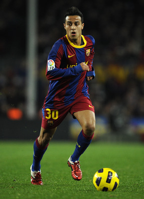 BARCELONA, SPAIN - JANUARY 02:  Thiago Alcantara of Barcelona runs with the ball during the La Liga match between Barcelona and Levante UD at Camp Nou on January 2, 2011 in Barcelona, Spain. Barcelona won 2-1.  (Photo by David Ramos/Getty Images)