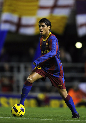 BARCELONA, SPAIN - JANUARY 08:  Jonathan dos Santos of FC Barcelona B (L) controls the ball during the La Liga Adelante match between FC Barcelona B and Girona at Mini Estadi on January 8, 2011 in Barcelona, Spain.  (Photo by David Ramos/Getty Images)