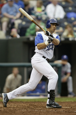 KANSAS CITY, MO - JUNE 10:  Outfielder Carlos Beltran #15 of the Kansas City Royals swings at a Montreal Expos pitch during the interleague game at Kaufmann Stadium on June 10, 2004 in Kansas City, Missouri.  The Expos won 8-0. (Photo by G. Newman Lowranc