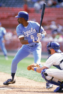 MILWAUKEE - 1990:  Willie Wilson #6 of the Kansas City Royals stands ready at the plate during a game against the Milwaukee Brewers in 1990 at Milwaukee County Stadium in Milwaukee, Wisconsin.  (Photo by Jonathan Daniel/Getty Images)