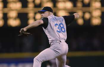 SEATTLE - AUGUST 30:  Pitcher Jason Grimsley #38 of the Kansas City Royals throws a pitch during the MLB game against the Seattle Mariners on August 30, 2002 at Safeco Field in Seattle, Washington.  The Royals defeated Mariners 5-1.  (Photo by Otto Greule