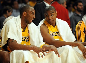 LOS ANGELES, CA - MAY 06:  (L-R) Kobe Bryant #24 of the Los Angeles Lakers talks with Andrew Bynum #17 on the bench against the Houston Rockets in Game Two of the Western Conference Semifinals during the 2009 NBA Playoffs at Staples Center on May 6, 2009