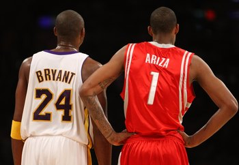 LOS ANGELES, CA - NOVEMBER 15:  Kobe Bryant #24 of the Los Angeles Lakers stands byTrevor Ariza #1 of the Houston Rockets on November 15, 2009 at Staples Center in Los Angeles, California.  The Rockets won 101-91.  NOTE TO USER: User expressly acknowledge