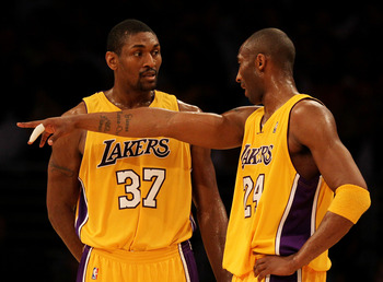 LOS ANGELES, CA - MAY 19:  Kobe Bryant #24 of the Los Angeles Lakers speaks with teammate Ron Artest #37 during the stop in play against the Phoenix Suns in Game Two of the Western Conference Finals during the 2010 NBA Playoffs at Staples Center on May 19