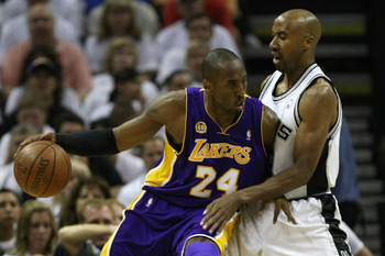 SAN ANTONIO - MAY 27:  Kobe Bryant #24 of the Los Angeles Lakers posts up Bruce Bowen #12 of the San Antonio Spurs in the first quarter of Game Four of the Western Conference Finals during the 2008 NBA Playoffs on May 27, 2008 at the AT&T Center in San An