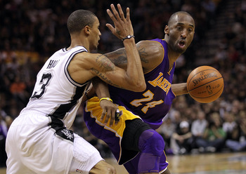 SAN ANTONIO, TX - DECEMBER 28:  Guard Kobe Bryant #24 of the Los Angeles Lakers dribbles the ball against George Hill #3 of the San Antonio Spurs at AT&T Center on December 28, 2010 in San Antonio, Texas.  NOTE TO USER: User expressly acknowledges and agr