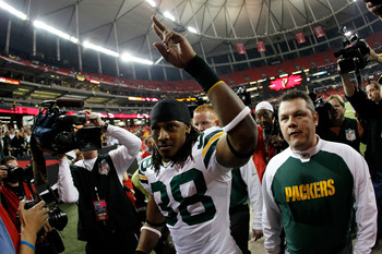 ATLANTA, GA - JANUARY 15:  Tramon Williams #38 of the Green Bay Packers celebrates as he walks off of the field after the Packers won 48-21 against the Atlanta Falcons during their 2011 NFC divisional playoff game at Georgia Dome on January 15, 2011 in At