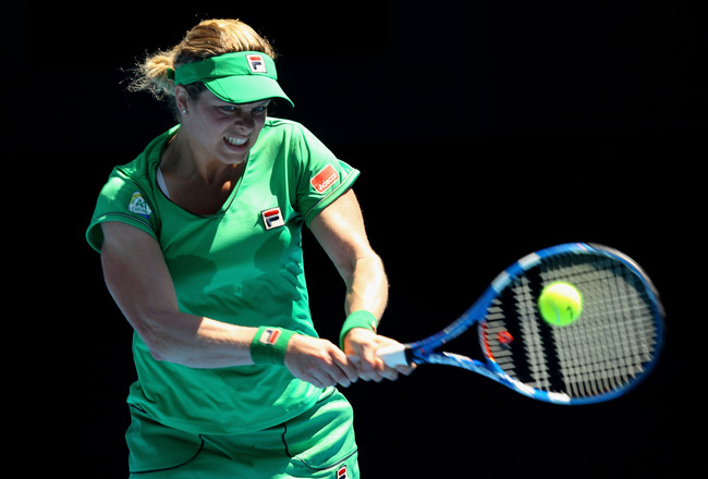 MELBOURNE, AUSTRALIA - JANUARY 20:  Kim Clijsters of Belgium plays a backhand in her second round match against Carla Suarez Navarro of Spain during day four of the 2011 Australian Open at Melbourne Park on January 20, 2011 in Melbourne, Australia.  (Phot