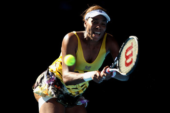 MELBOURNE, AUSTRALIA - JANUARY 19:  Venus Williams of the United States of America plays a backhand in her second round match against Sandra Zahlavova of the Czech Republic during day three of the 2011 Australian Open at Melbourne Park on January 19, 2011