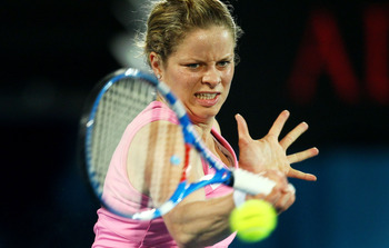 SYDNEY, AUSTRALIA - JANUARY 14: Kim Clijsters of Belgium plays a forehand in the womens final against Na Li of China during day six of the 2011 Medibank International at Sydney Olympic Park Tennis Centre on January 14, 2011 in Sydney, Australia.  (Photo b