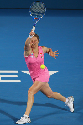 SYDNEY, AUSTRALIA - JANUARY 14:  Kim Clijsters of Belgium plays a forehand in the women's final against Na Li of China during day six of the 2011 Medibank International at Sydney Olympic Park Tennis Centre on January 14, 2011 in Sydney, Australia.  (Photo