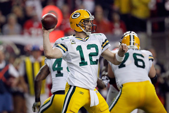 ATLANTA, GA - JANUARY 15:  Quarterback Aaron Rodgers #12  of the Green Bay Packers throws a pass against the Atlanta Falcons during their 2011 NFC divisional playoff game at Georgia Dome on January 15, 2011 in Atlanta, Georgia.  (Photo by Kevin C. Cox/Get