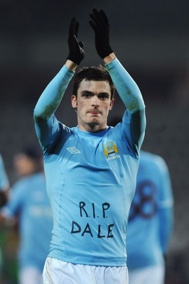 TURIN, ITALY - DECEMBER 16:  Adam Johnson of Manchester City salutes the crowd at the end of the UEFA Europa League group A match between Juventus FC and Manchester City at Stadio Olimpico di Torino on December 16, 2010 in Turin, Italy.  (Photo by Valerio