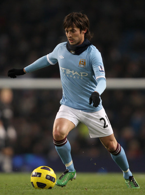 MANCHESTER, ENGLAND - DECEMBER 20:  David Silva of Manchester City in action during the Barclays Premier League match between Manchester City and Everton at City of Manchester Stadium on December 20, 2010 in Manchester, England.  (Photo by Clive Brunskill