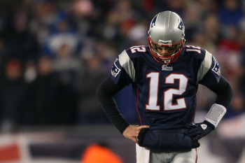 FOXBORO, MA - JANUARY 16:  Tom Brady #12 of the New England Patriots looks on near the end of their 28 to 21 loss to the New York Jets in their 2011 AFC divisional playoff game at Gillette Stadium on January 16, 2011 in Foxboro, Massachusetts.  (Photo by
