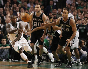BOSTON, MA - JANUARY 05:  Nate Robinson #4 of the Boston Celtics avoids getting fouled by Tony Parker #9,Manu Ginobili #20 and Richard Jefferson #24 of the San Antonio Spurs on January 5, 2011 at the TD Garden in Boston, Massachusetts. The Celtics defeate