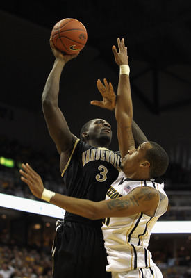 COLUMBIA, MO - DECEMBER 08:  Festus Ezeli #3 of the Vanderbilt Commodores shoots over Laurence Bowers #21 of the Missouri Tigers during the game on December 8, 2010 at Mizzou Arena in Columbia, Missouri.  (Photo by Jamie Squire/Getty Images)