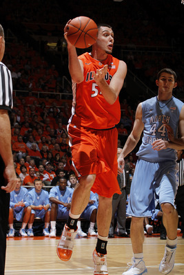 CHAMPAIGN, IL - NOVEMBER 30: Mike Tisdale #54 of the Illinois Fighting Illini saves the basketball from going out of bounds against the North Carolina Tar Heels during the 2010 ACC/Big Ten Challenge at Assembly Hall on November 30, 2010 in Champaign, Illi