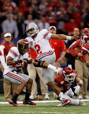 NEW ORLEANS, LA - JANUARY 04:  Terrelle Pryor #2 of the Ohio State Buckeyes runs with the football as he avoids a tackle by Isaac Madison #6 of the Arkansas Razorbacks in the first quarter during the Allstate Sugar Bowl at the Louisiana Superdome on Janua