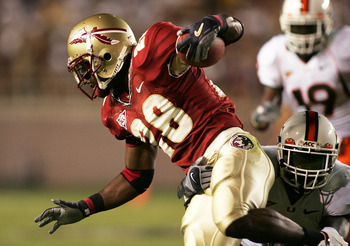 TALLAHASSEE, FL - SEPTEMBER 05:  Running back Lorenzo Booker #28 of the Florida State Seminoles avoids a tackle against the Miami Hurricanes at Doak Campbell Stadium on September 5, 2005 in Tallahassee, Florida. Florida State defeated Miami 10-7.  (Photo