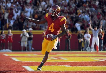 LOS ANGELES, CA - NOVEMBER 14:  Joe McKnight #4 of the USC Trojans celebrates his touchdown against the Stanford Cardinals during the second half at the Los Angeles Memorial Coliseum on November 14, 2009 in Los Angeles, California.  (Photo by Harry How/Ge