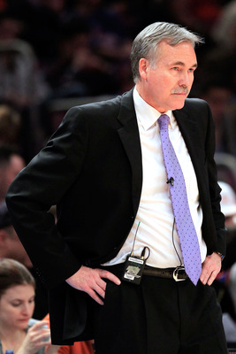 NEW YORK, NY - JANUARY 14: Head coach Mike D'Antoni of the New York Knicks stands near the bench during the game against the Sacramento Kings at Madison Square Garden on January 14, 2011 in New York City. NOTE TO USER: User expressly acknowledges and agre