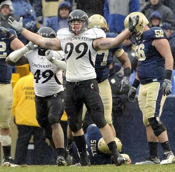 Bearcats DL Dan Giordano celebrates a tackle for less against Big East rival Pitt
