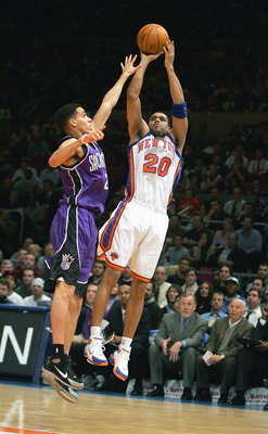 NEW YORK - JANUARY 4:  Allan Houston #20 of the New York Knicks shoots a jump shot against Kevin Martin #23 of the Sacramento Kings on January 4, 2005 at Madison Square Garden in New York City. The Kings won 105-98.  NOTE TO USER: User expressly acknowled
