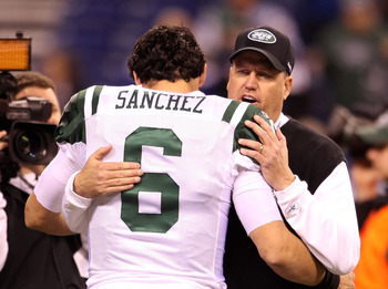 INDIANAPOLIS, IN - JANUARY 08:  Head coach Rex Ryan and Mark Sanchez #6 of the New York Jets talk on the field during warm ups against the Indianapolis Colts during their 2011 AFC wild card playoff game at Lucas Oil Stadium on January 8, 2011 in Indianapo
