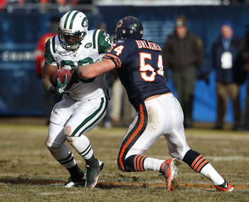 CHICAGO, IL - DECEMBER 26: Brian Urlacher #54 of the Chicago Bears brings down Shonn Greene #23 the New York Jets at Soldier Field on December 26, 2010 in Chicago, Illinois. The Bears defeated the Jets 38-34. (Photo by Jonathan Daniel/Getty Images)