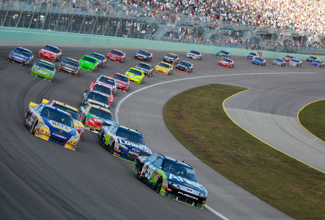 HOMESTEAD, FL - NOVEMBER 21:  Carl Edwards, driver of the #99 Aflac Ford, leads the field during the NASCAR Sprint Cup Series Ford 400 at Homestead-Miami Speedway on November 21, 2010 in Homestead, Florida.  (Photo by Chris Graythen/Getty Images)