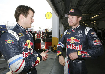 DAYTONA BEACH, FL - JANUARY 20:  Kasey Kahne, driver of the #4 Red Bull Toyota talks with Brain Vickers, driver of the #83 Red Bull Toyota during testing at Daytona International Speedway on January 20, 2011 in Daytona Beach, Florida.  (Photo by Jerry Mar