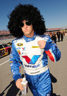 TALLADEGA, AL - OCTOBER 31:  AJ Allmendinger, driver of the #43 Valvoline Ford walk to pre-race activities for the NASCAR Sprint Cup Series AMP Energy Juice 500 at Talladega Superspeedway on October 31, 2010 in Talladega, Alabama.  (Photo by Rusty Jarrett