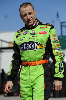 DAYTONA BEACH, FL - JANUARY 22:  Mark Martin, driver of the #5 GoDaddy.com Chevrolet, walks through the garage during testing at Daytona International Speedway on January 22, 2011 in Daytona Beach, Florida.  (Photo by Jared C. Tilton/Getty Images for NASC