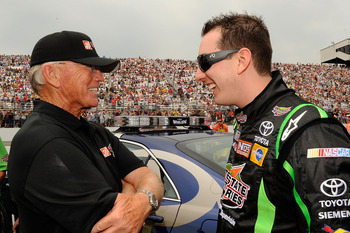 LOUDON, NH - JUNE 27:  Kyle Busch (R), driver of the #18 Interstate Batteries Toyota, talks with team owner Joe Gibbs on the grid prior to the start of the NASCAR Sprint Cup Series LENOX Industrial Tools 301 at New Hampshire Motor Speedway on June 27, 201